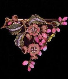 Enameled gold brooch in the form of a branch of wild rose, set with conch pearls as the buds.