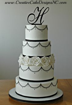 alexia dives posted Buttercream wedding cake with piped royal icing details.Complete with edible sugar roses. to their -wedding cakes- postboard via the Juxtapost bookmarklet. Black And White Wedding Cake, White Wedding Cakes, Amazing Wedding Cakes, Amazing Cakes, Pretty Cakes, Beautiful Cakes, Cupcakes, Cupcake Cakes, Pastel Cakes
