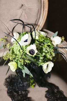 Black and white bouquet with #anemones, our fave - photo by Julie Wilhite Photography, flowers by Sweet Magnolia Floral Studio http://ruffledblog.com/roaring-romance-wedding-inspiration/ #bouquets