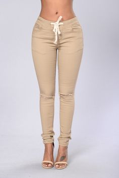 - Available in Black, Olive, White, Wheat and Camo - Elastic Waistband - Drawstring Cord - 5 Pocket Design - Skinny Leg - Slit Knee - 97% Cotton 3% Spandex