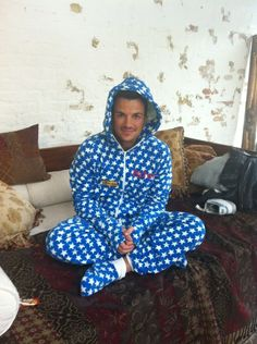 Blue Star Onesie as worn by Peter Andre    Complete with front zip, thumb cuffs, hood, front pockets and i-pocket