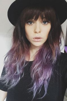 Wavy brown and purple ombré with bangs