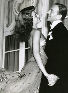 Rita Hayworth and Fred Astaire - look how she lights up the room. She is totally absorbed in the moment.