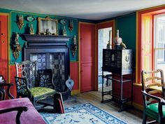 Who says antiques have to be dusty and drab? This living room proves that color and character can coexist — vibrantly.