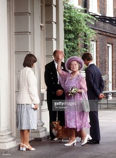 The Queen Mother With Her Grandchildren, Prince Edward And Lady Sarah Armstrong-jones, Entering Clarence House With One Of Her Corgis
