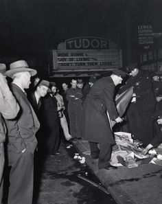 Weegee (Arthur Fellig), This man covered up with newspapers was killed in an auto accident. The driver of the car was arrested, but he put up such a terrific battle. cops had to put handcuffs on him. Weegee Photography, History Of Photography, Street Photography, Night Photography, 42nd Street, New York Street, New York City, Ukraine, Irene Dunne
