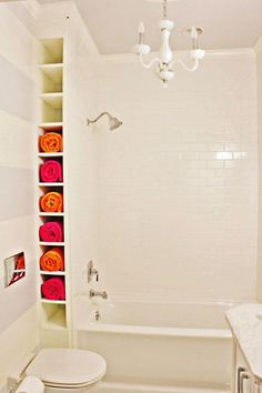 A nook by the tub. Create a ceiling height rack between wall and tub. The space may be small but they're perfect for storing rolled towels.