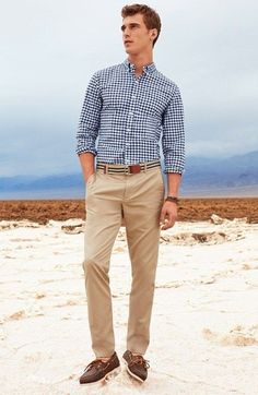Men's Navy and White Gingham Long Sleeve Shirt, Tan Horizontal Striped Canvas Belt, Khaki Chinos, and Dark Brown Leather Boat Shoes