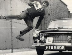 Jumping for joy: George Best is all smiles after passing his driving test in Belfast in 1965. Best had played his Man United debut in 1963. Manchester United 1 West Bromwich 0 Saturday September 14, 1963 Football League Division One - Old Trafford United line-up: Harry Gregg, Tony Dunne, Noel Cantwell, Paddy Crerand, Bill Foulkes, Maurice Setters, George Best, Nobby Stiles, David Sadler, Phil Chisnall, Bobby Charlton