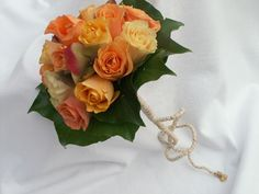 Apricot, cream and lemon roses, Hydrangea, Ivy