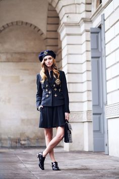 military outfit with brooches and oxfords