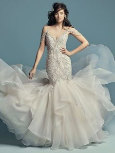 There is a time and a place for modest simplicity, but this particular webpage is reserved for fans of the shimmery + glamorous mermaid wedding dress only.