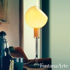 The Parola lamp features three different kinds of glass working processes. #FontanaArte #tablelamp #GaeAulenti #PieroCastiglioni Available at allmodernoutlet.com  http://www.allmodernoutlet.com/fontanaarte-parola-table-lamp/