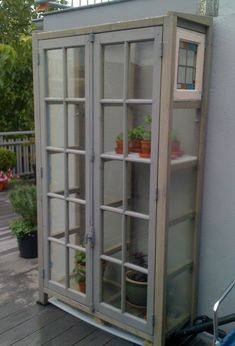 I think i will have to make one of these only model it after the Dr who tardis is part of Indoor greenhouse - Diy Greenhouse Plans, Outdoor Greenhouse, Greenhouse Interiors, Backyard Greenhouse, Small Greenhouse, Recycled Door, Recycled Windows, Diy Fence, Fence Ideas