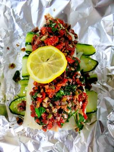 Olive Crusted Cod in Foil - Holy yum! Like an olive tapenade with sundried tomatoes on top of cod, which is on top of zuchinni ribbons, which is drizzled with lemon goodness...which sounds divine!