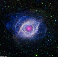 The 'eye in the sky': Breathtaking new pictures of the Helix Nebula, a dying star 650 light years from Earth - It shows the star's dusty outer layers unraveling into space, glowing from the intense ultraviolet radiation being pumped out by the hot stellar core.