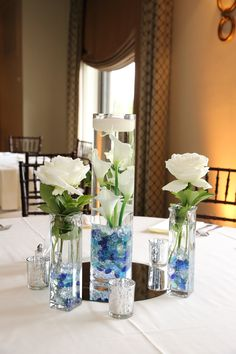 White rose and vases centerpieces for wedding.  See more wedding inspiration at: www.kristingriffinphotography.com #hansonweddingphotographer #bostonweddingphotographer #halifaxweddingphotographer #maweddingphotographer #maweddingphotography #bestweddingphotographer