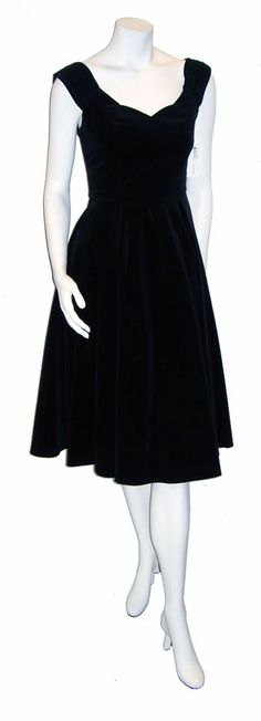 $95.00  This 1950's style black velveteen dress was made by Candy Jones. After a bit of research I found that Candy Jones specialized in vintage inspired items. This is an absolutely perfect 70's or 80's 50's style dress and could fool even the most expert vintage hounds!