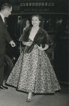 """Photo of Princess Margaret arriving at the Scala Theatre, London, to see a charity performance of the Gay 'Nineties comedy """"Lord and Lady Algy,"""" May 28, 1953. She is wearing a Norman Hartnell dress in pink silk and black lace (now in the collection of the Fashion Museum Bath). Photo via romanbenedikhanson on Flickr."""