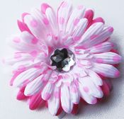 This flower is absolutely the cutest daisy!! This precious designer daisy has layers of white with pink dots and solid pink. This little flower will be a great addition to any hair collection. Available with or with out a clip.  Only $2.99 at Wholesaleprincess.com