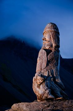 A 9 foot wooden carving stands over a lake and mountain near Hofn in the east fjords of Iceland. As a rare resource in Iceland, wood was valuable. So much so, that beaches that attracted driftwood were highly valuable and sought after.