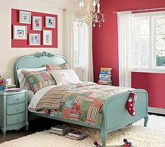 The bed is often used as a focal point in designing a bedroom. Note that the color red is used on one wall and the art space above the bed, complementing the light blue bed set.
