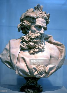 Neptune, Roman god of the oceans. Antique bust of Neptune, known as Poseidon in the Greek pantheon.