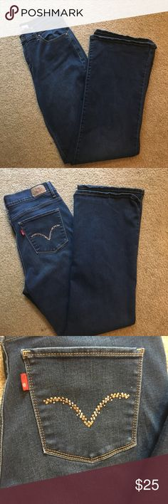 Levi's perfectly slimming jeans Perfectly slimming 512 bootcut jeans with silver embellished pockets. Regular rise.  All measurements are approx. Levi's Jeans Boot Cut