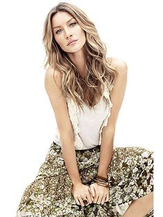 This top, the long flowing print skirt, and the loose, natural long hair ... it's boho all the way.