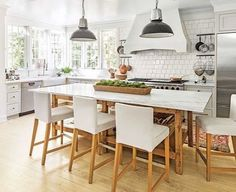 What a charming kitchen! I would ❤️ to be sitting at that island in that comfy chair this morning enjoying my coffee. Happy Monday y'all! Hope you enjoy this kitchen inspiration as much as I do! Via @southernlivingmag Lauren W. Glenn