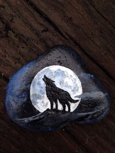 Handpainted HOWLING WOLF FULL MOON Stone curio or paperweight. Natural smooth river rock found at a State Park, and painted in muted midnight colors. Measuring about 2 X 2 sizes and shapes will vary due to the very nature of rocks being one of a kind. Rock Painting Patterns, Rock Painting Ideas Easy, Rock Painting Designs, Wolf Painting, Stone Painting, Wolf Howling At Moon, Diy Y Manualidades, Painted Rocks Kids, House On The Rock