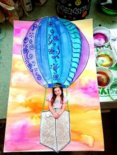 Watercolor hot air balloon and background with the child's picture.