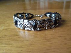 Black glass, white crystal and silver bracelet by StrungOnLove on Etsy