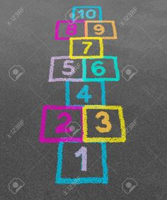 Hopscotch in a schoolyard on an asphalt floor with chalk drawings of numbers and squares as a symbol of youth innocence and children playing a fun play ground jumping game at recess or after elementary school Stock Photo - 13559417 Playground Painting, Playground Games, Outside Games, Paper Structure, Chalk Drawings, Hopscotch, Sidewalk Chalk, Games For Kids, Kids Playing