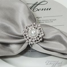 Click for the most beautiful diamante and pearl napkin rings for your big day!  These are only $2!!!! www.totallydazzled.com