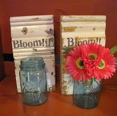 ball jars wired to door trim...hang on front door and fill with blooms.