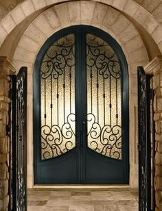 THESE doors are what's up.  Love the arch.  Arched Double Doors - mediterranean - front doors - phoenix - Colletti Design Iron Doors