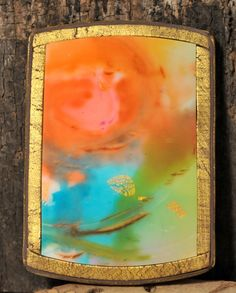 A wonderful natural scene of a pond, the setting sun along side a meadow.  This effect was created using alcohol inks over a blue-white poly...