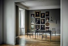 How to hang old paintings in a modern setting!  Love it!