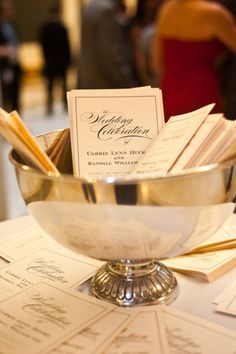 classic wedding program display - I like the idea of putting it in a silver bowl