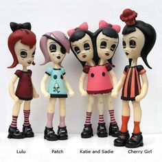 by Camille Rose Garcia.  I have these dolls....they make me very happy!