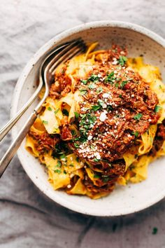 Simple weekend braised beef ragu that's perfect for Sunday supper. Just set it up and let it slow simmer until the meat starts falling apart. So comforting!