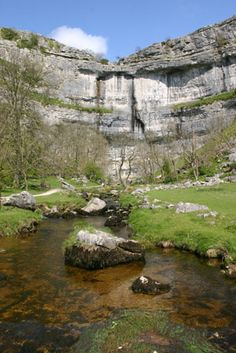 """I am not sure which experience of Malham Cove has left the biggest impression on me: the first time I stood below it gazing at the breathtaking scale of the curved wall in front maybe, or later that same day lying at the top with just my face over the overhang lip and 260 feet of dizzying space below. Wherever it is viewed from, this is an awe-inspiring place that well deserves its ranking in a recent list of Seven Natural Wonders of Britain."" Slow Travel Yorkshire Dales…"