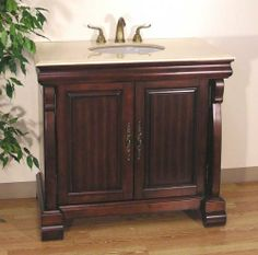 """Dabney Sink Chest in Dark Brown by Legion Furniture. $1090.00. Color: Dark Brown. Ample Storage. This item ships common carrier.. Cream Marble Top. Size: 35.5""""H x 38""""W x 22""""D. This Bathroom Vanity features a transitional design that includes modern and classic elements. Made of solid birch wood, this vanity cabinet has a deep brown finish that is contrasted nicely by a 1.5 cm crema marfil top with undermount white ceramic sink. The large vanity cabinet underneath offe..."""