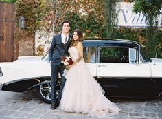 bride and groom with vintage car shot by Troy Grover Photographers