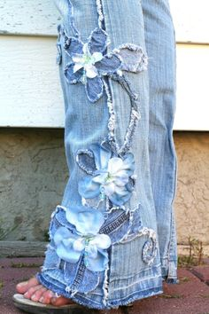 by cutting little strips of blue jean and sewing strips in middle to pants in the design you want