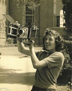 Super cool looking girl with a camera (vintage photo). :)