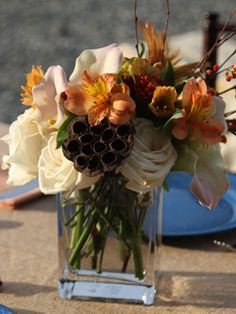 Standard grocery store bouquets of roses or mums with a few natural elements, like feathers and dried wheat.