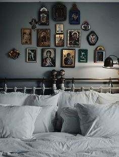 Photo by Anders Bergstedt of white and grey bedroom with Mexican art