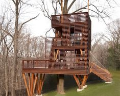 Modern Treehouse.....continuity of railings and siding. Would be nice even if not elevated.